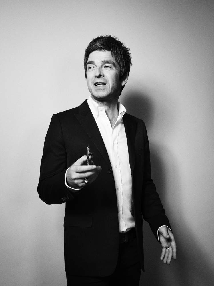 Black wool jacket, £2,100; white cotton shirt, £370, both by Dior Homme. Belt by Comme des Garçons. Sunglasses by Garrett Leight California Optical<br /><br /><em>Noel Gallagher photographed in London, September 2015</em>